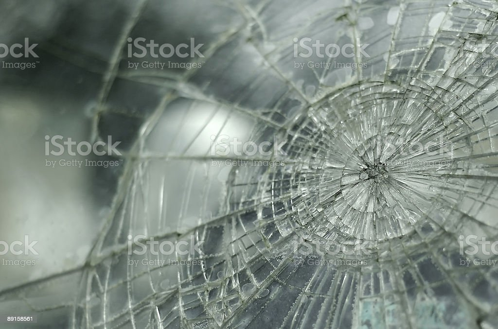 Close-up of a cracked glass windshield stock photo