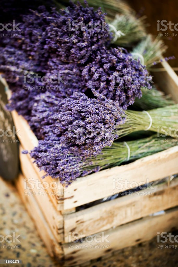 Close-up of a crate full of in bloom lavender bundles royalty-free stock photo