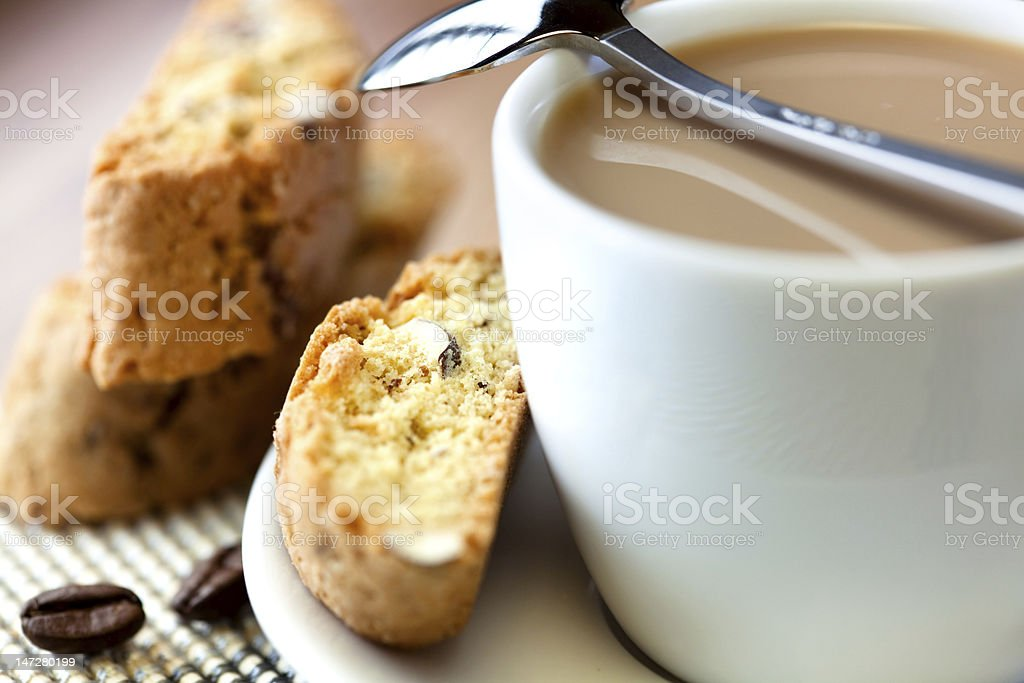 Close-up of a cup of coffee with milk and cantuccini royalty-free stock photo