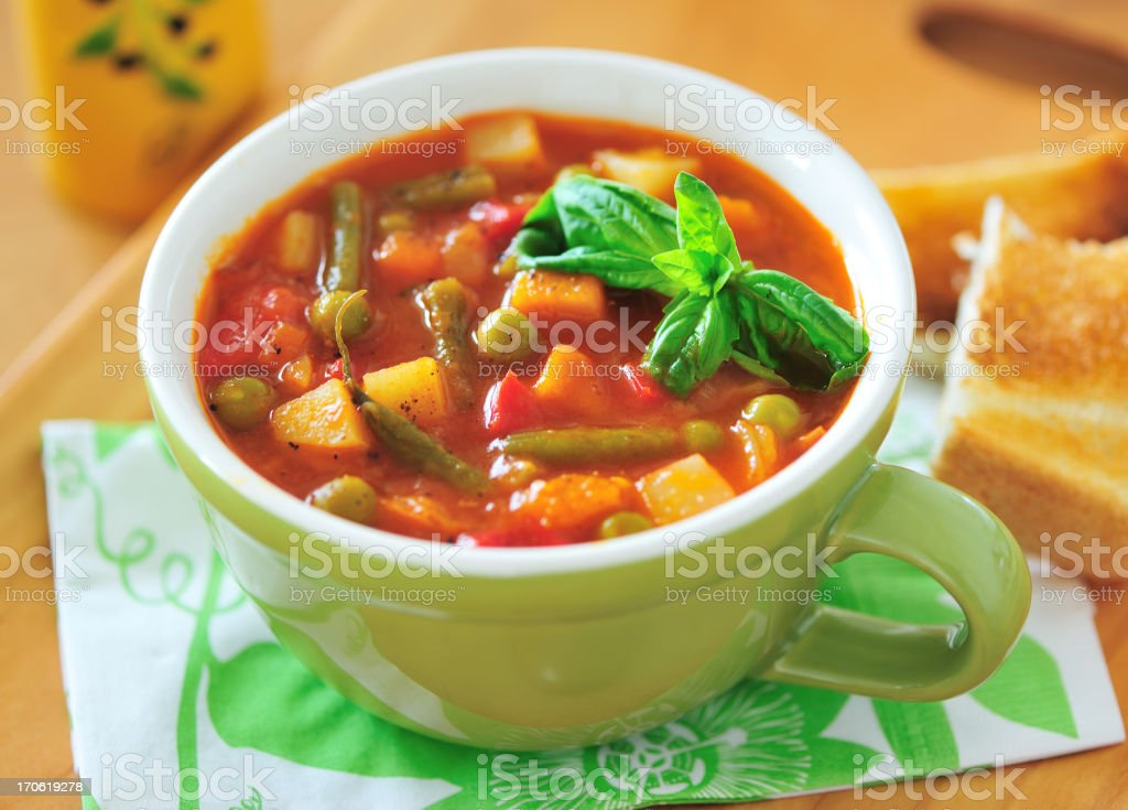 Close-up of a cup of minestrone soup stock photo