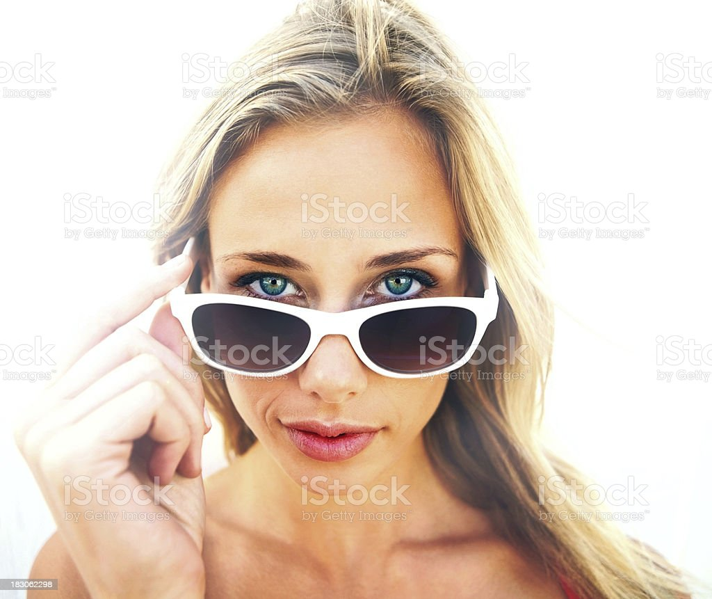 Closeup of a cute blond woman wearing sunglasses royalty-free stock photo