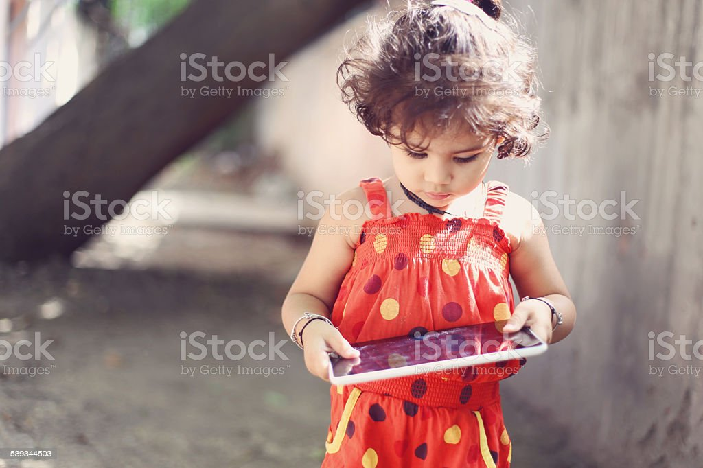 Close-up of a cute little girl using a digital tablet stock photo