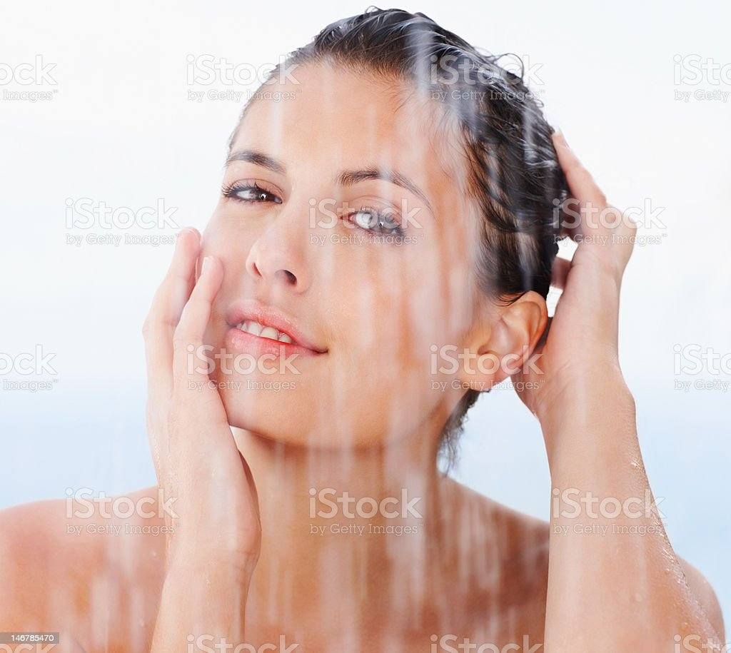 Closeup of a cute young woman under the shower stock photo