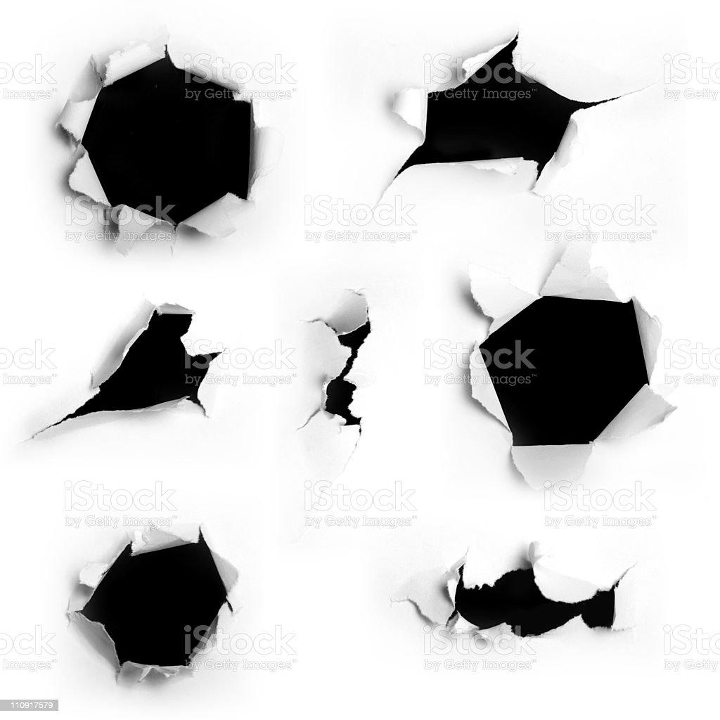 Closeup of a dark holes on white paper set royalty-free stock photo