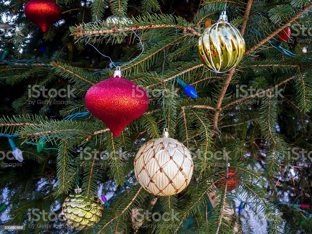 Closeup of a Decorated Christmas Tree With Many Ornaments stock photo