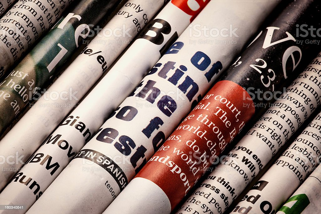 Close-up of a diagonal row of newspapers and magazines stock photo