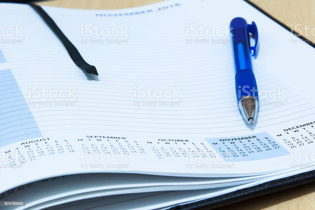 closeup of a diary with pen stock photo