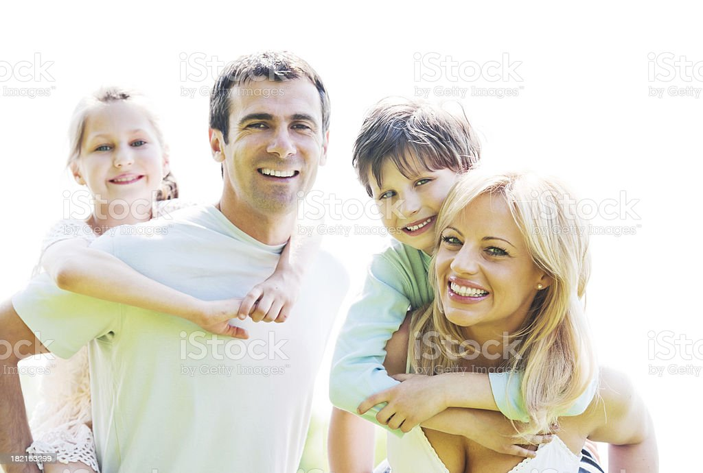 Close-up of a family smiling at the camera. royalty-free stock photo