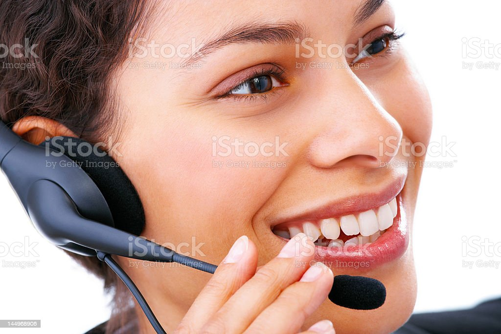 Close-up of a female customer service representative using headphones royalty-free stock photo
