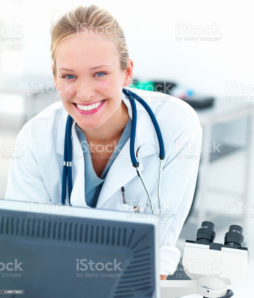 Close-up of a female doctor smiling and working in laboratory royalty-free stock photo