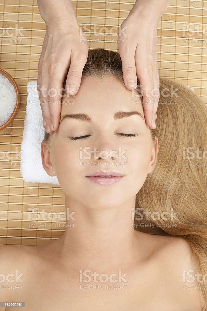 Close-up of a female receiving facial massage royalty-free stock photo
