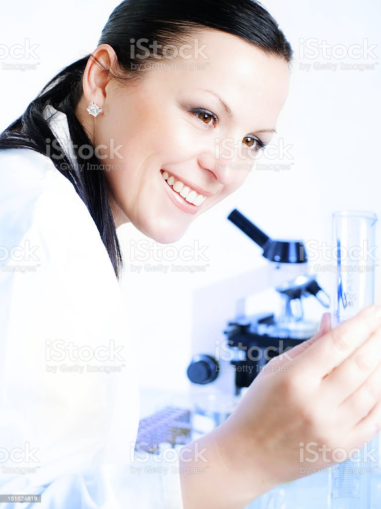 Closeup of a female researcher holding up test tube royalty-free stock photo