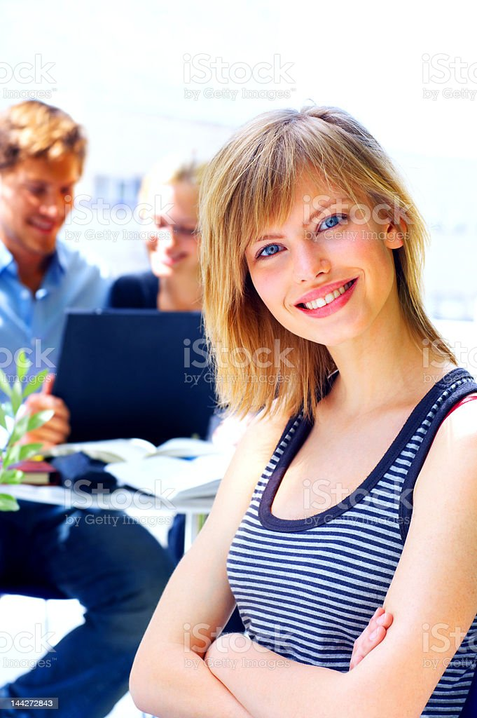 Close-up of a female young student smiling royalty-free stock photo