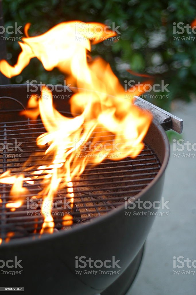 Close-up of a fiery barbecue grill royalty-free stock photo