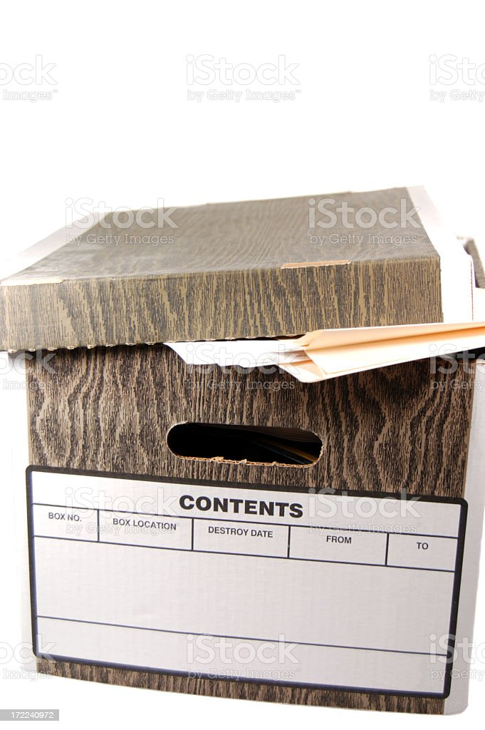 Close-up of a file box with folders and documents inside stock photo