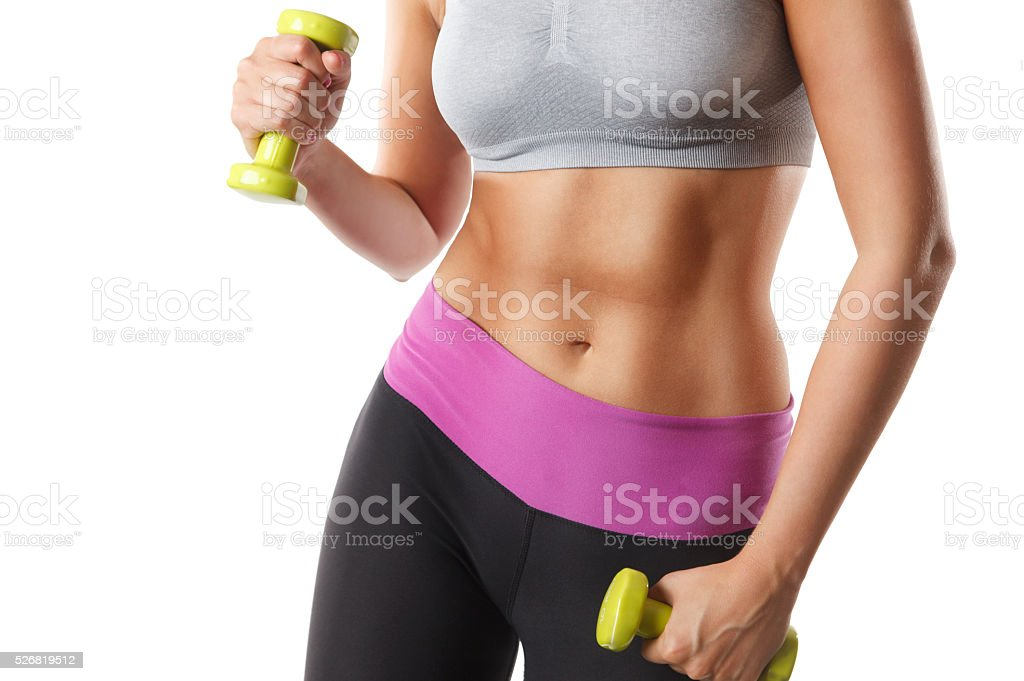 Close-up of a fit woman's toned abs stock photo