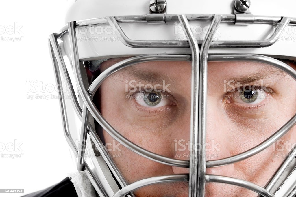 Close-up of a focused hockey goalie behind his mask royalty-free stock photo