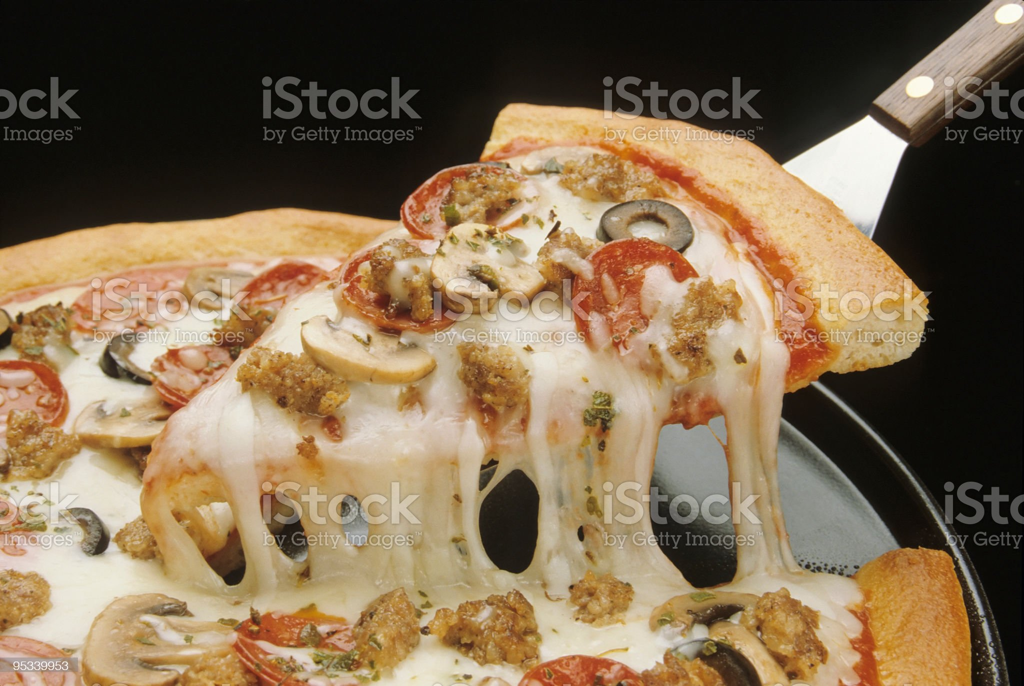 Close-up of a fresh pizza being served royalty-free stock photo