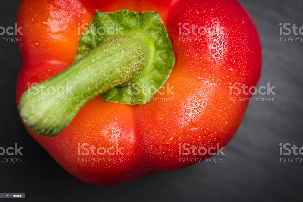 Closeup of a fresh red pepper. stock photo