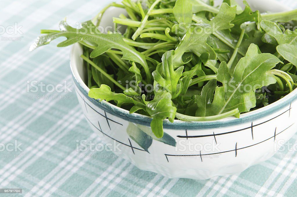 Close-up of a fresh rocket salad in a bowl stock photo