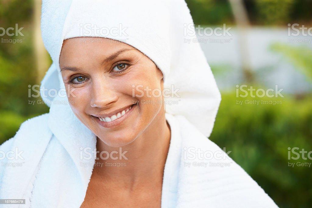Closeup of a fresh woman after bath smiling at dayspa royalty-free stock photo