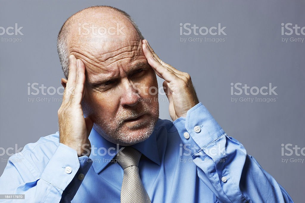 Closeup of a frustrated senior business man royalty-free stock photo