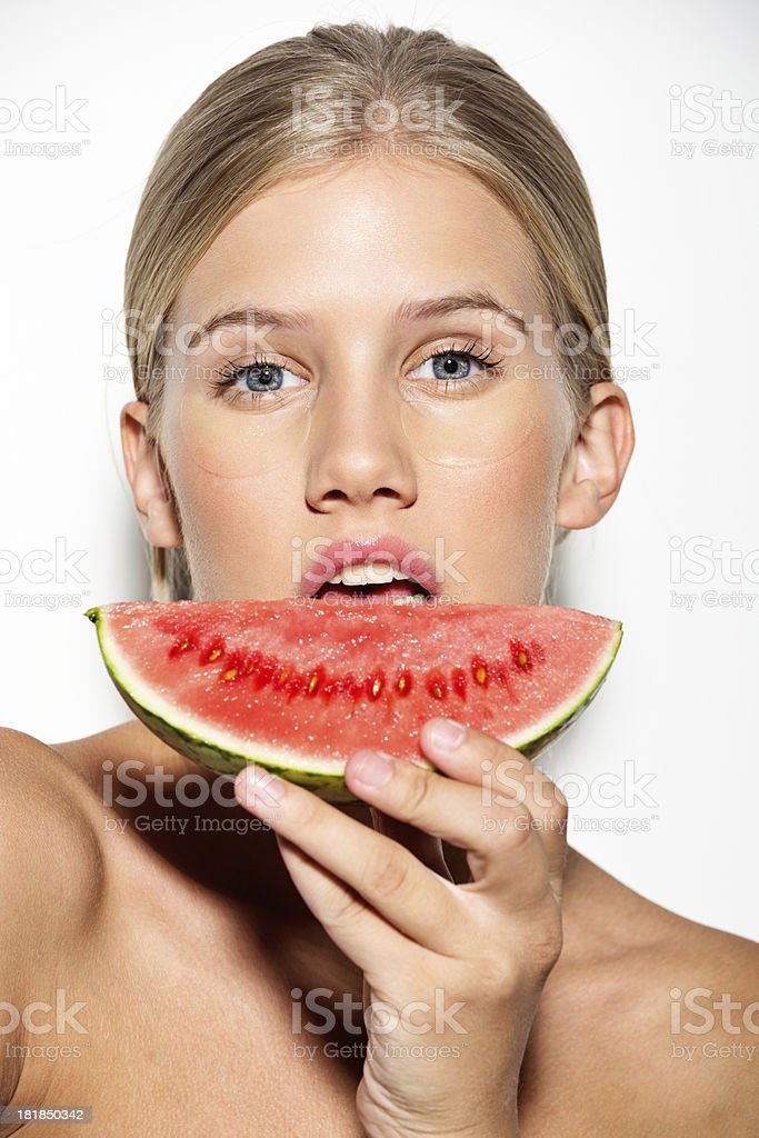 closeup of a girl holding watermelon in front her face royalty-free stock photo