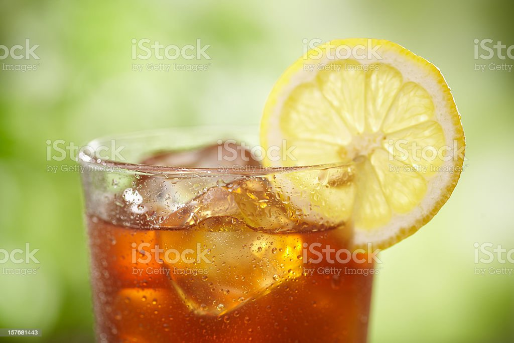 A close-up of a glass of iced tea with lemon stock photo