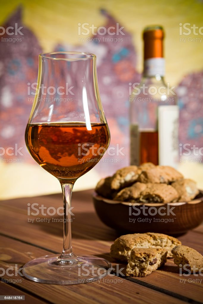 Closeup of a glass of Italian vin santo wine and cantucci biscuits stock photo