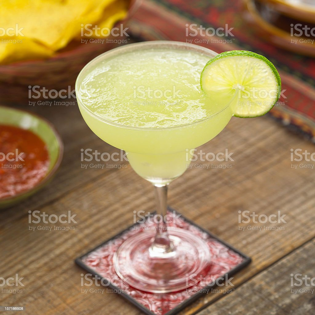 Close-up of a glass of margarita on a red coaster stock photo
