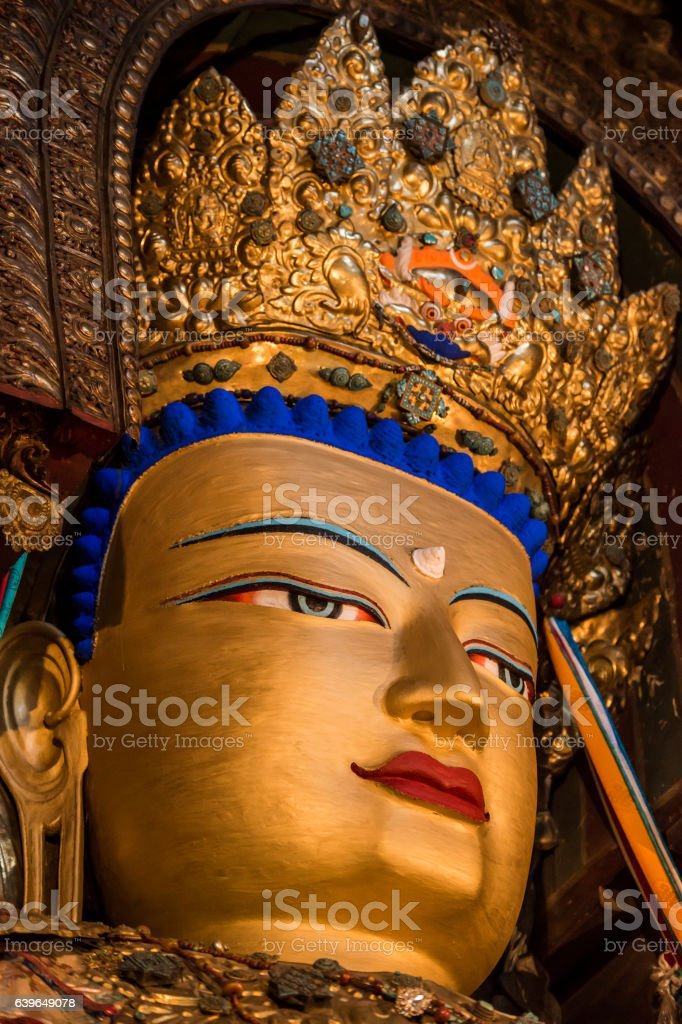 close-up of a golden Buddha statue, Eastern Tibet stock photo