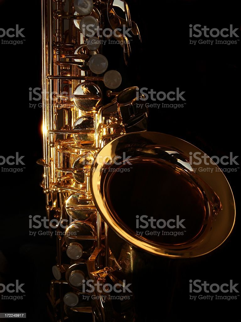 Close-up of a golden saxophone on a black background stock photo