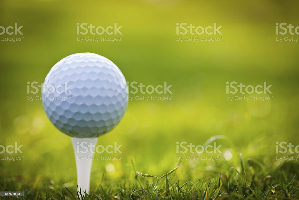 Close-up of a golf ball on a tee stock photo