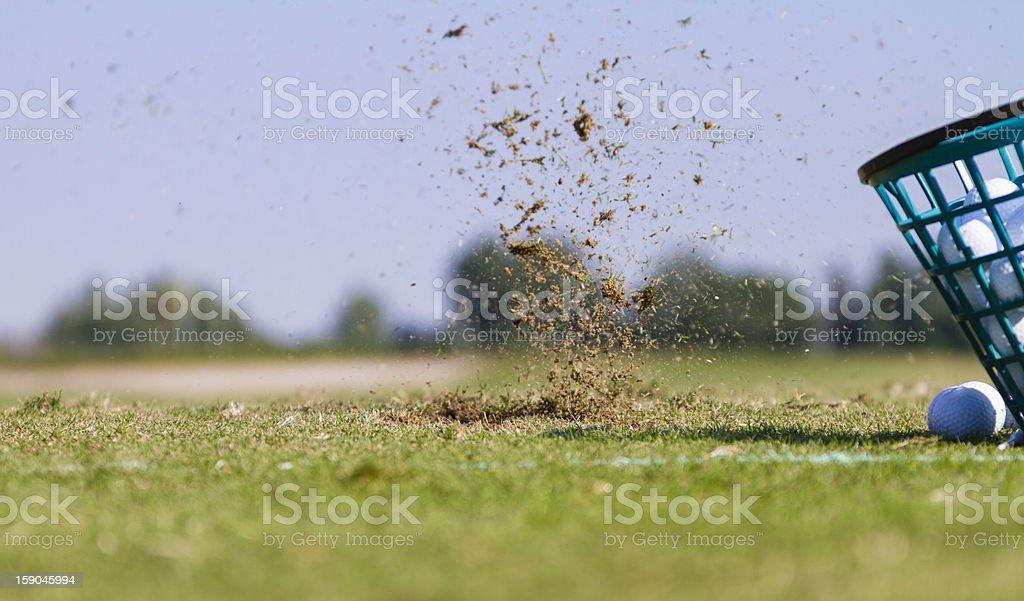 Closeup of a golf bucket and ball stock photo