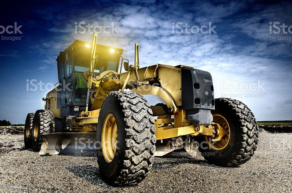 A close-up of a grader sitting outdoors stock photo