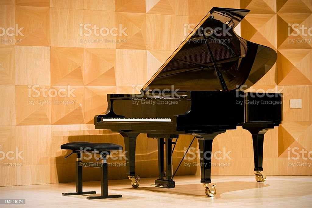 Close-up of a grand piano in concert hall, shallow DOF royalty-free stock photo