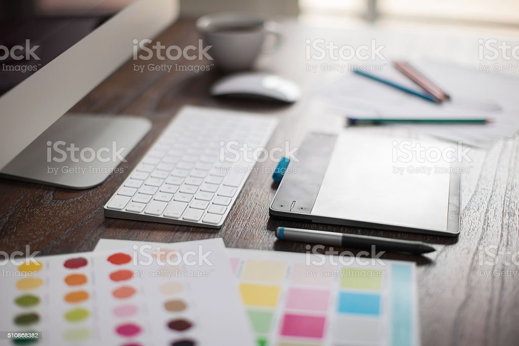 Closeup of a graphic designer's desk stock photo