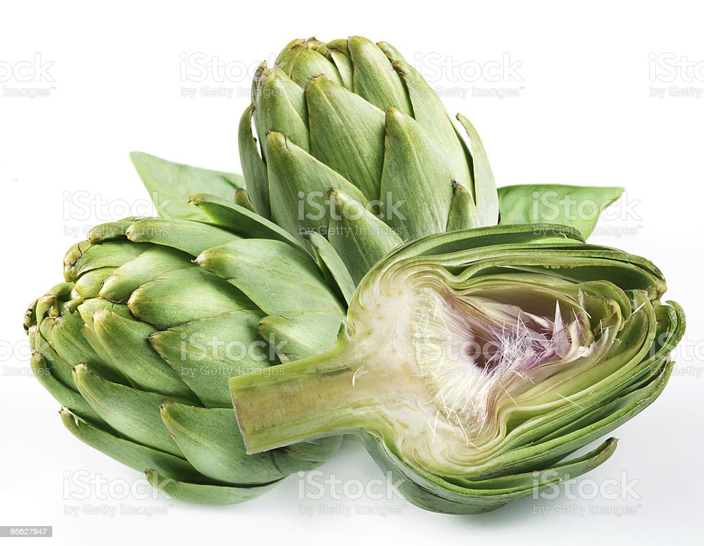 Close-up of a green artichoke isolated on white background stock photo