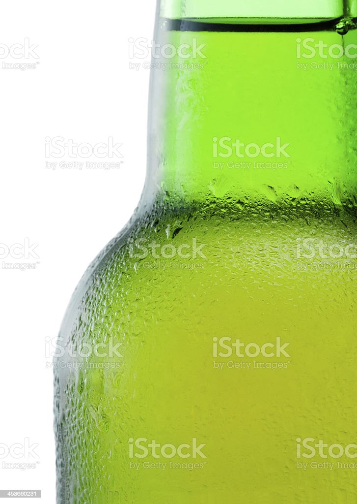 Close-up of a green beer bottle with condensation on white royalty-free stock photo