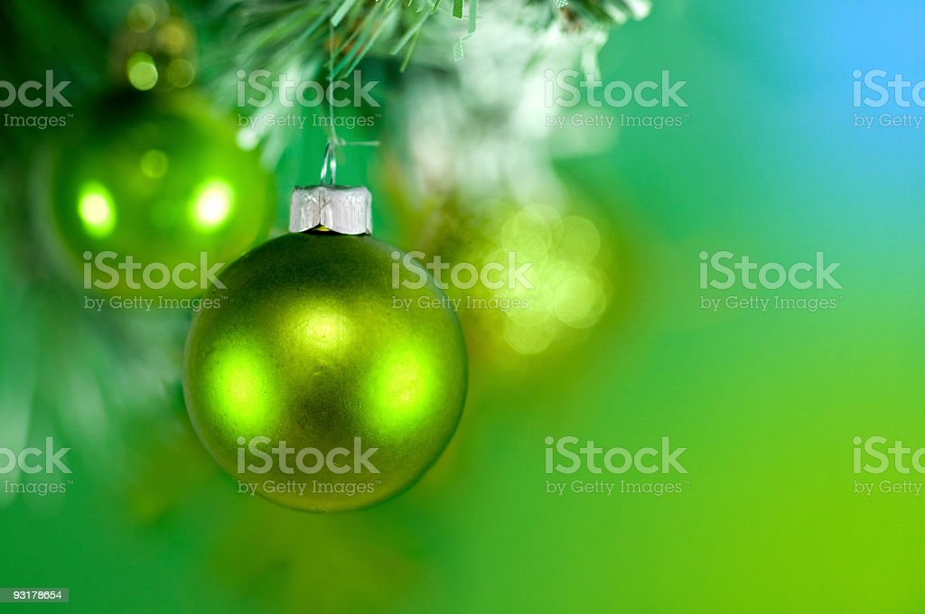 Close-up of a green Christmas bauble hanging on a tree royalty-free stock photo