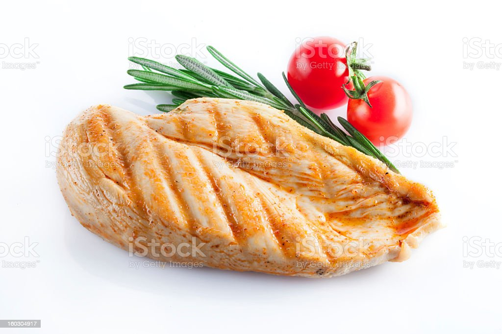 Close-up of a grilled chicken breast on white backdrop stock photo