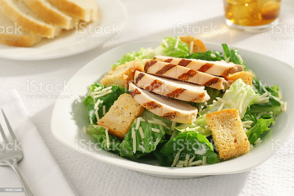 A close-up of a grilled chicken Caesar salad for lunch stock photo