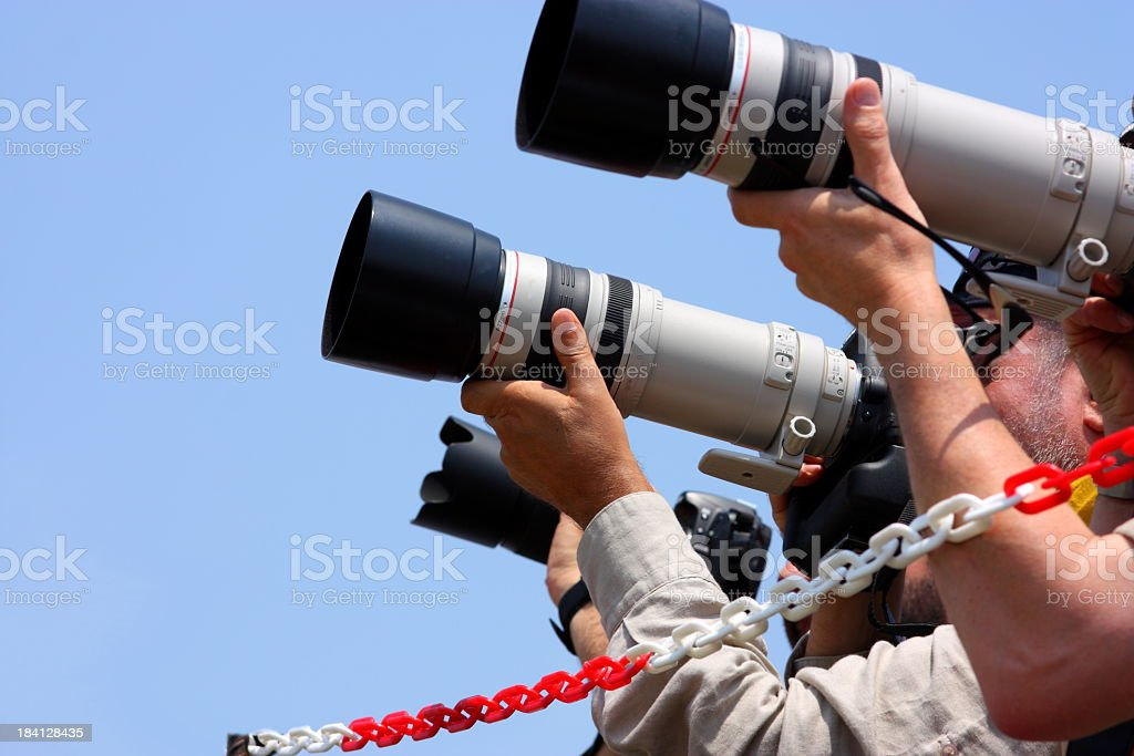 A close-up of a group of photographers stock photo