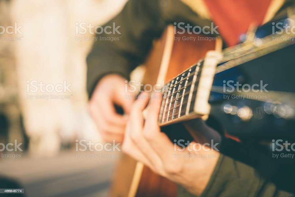 Close-up of a guitar player with a blurred background stock photo