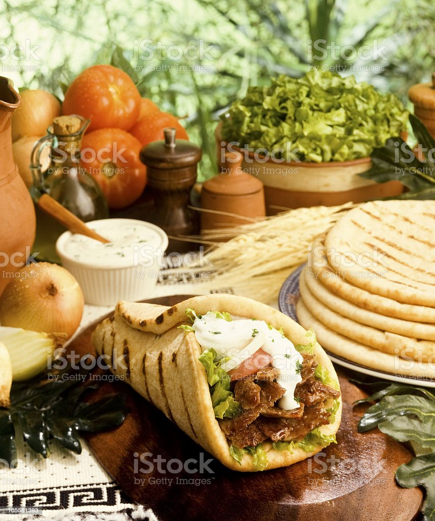 Close-up of a gyro with pita and other ingredients stock photo