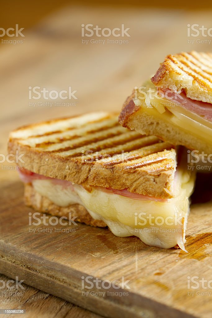 A closeup of a ham and cheese panini sandwich stock photo