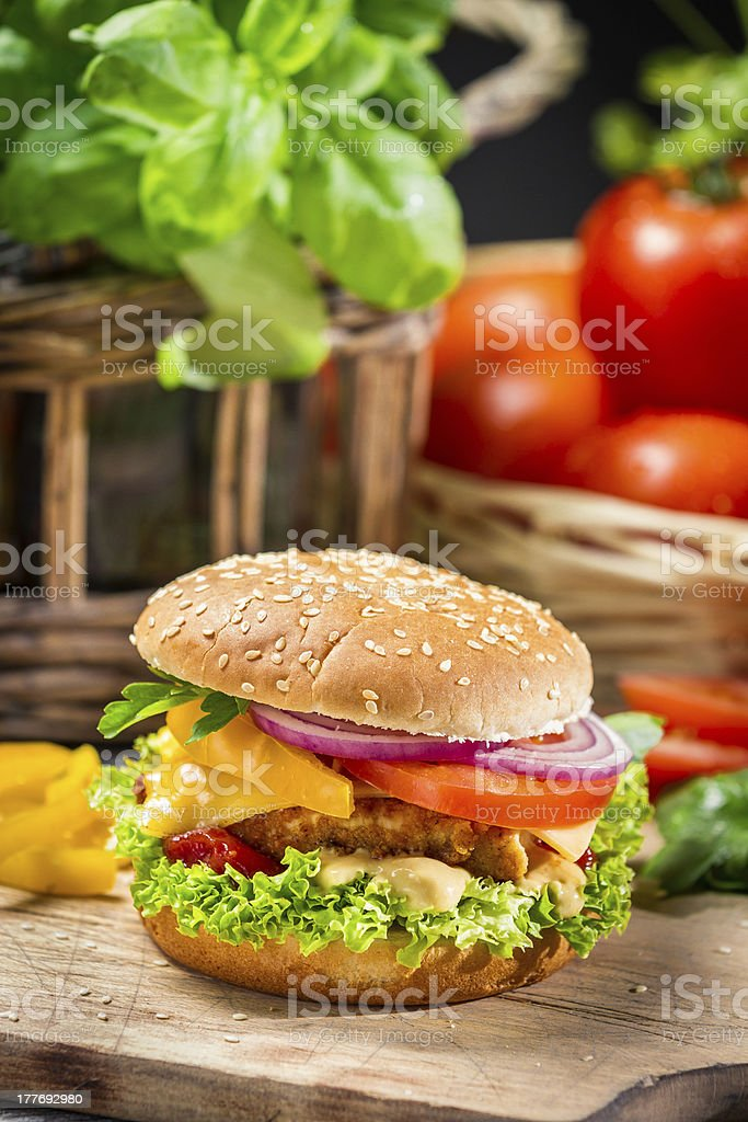 Closeup of a hamburger with chicken and fresh vegetables royalty-free stock photo