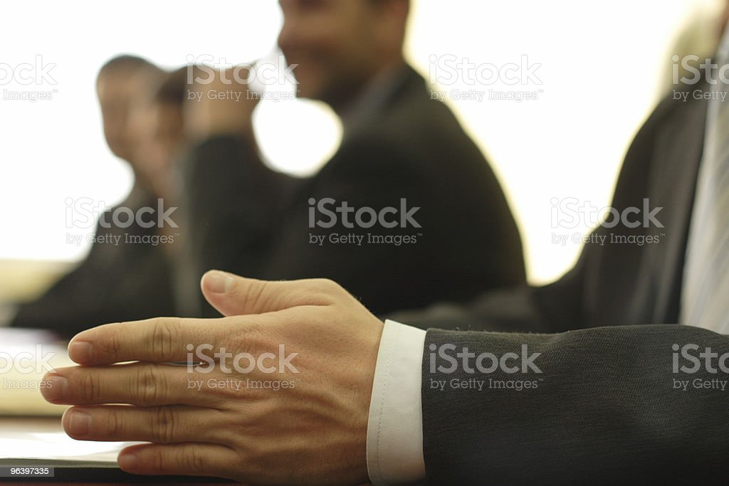 Close-up of a hand in business meeting royalty-free stock photo