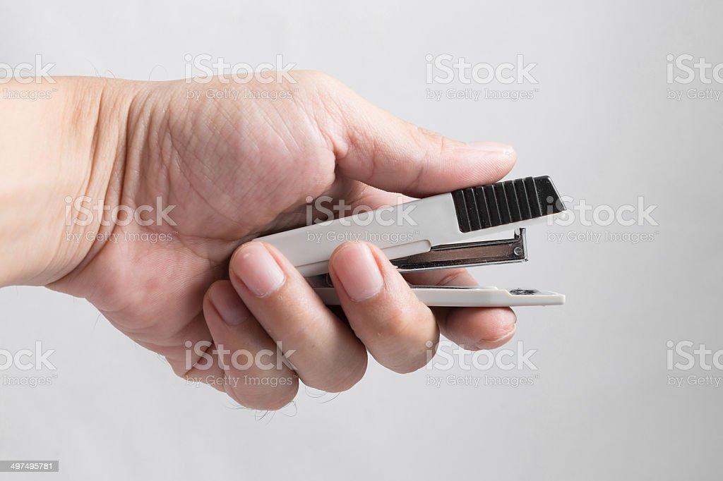 closeup of a hand using a stapler stock photo