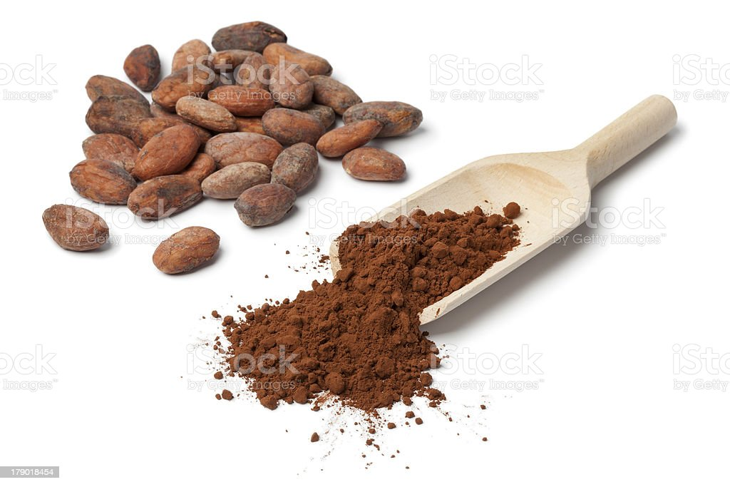 Close-up of a handful of whole and grounded cocoa beans royalty-free stock photo